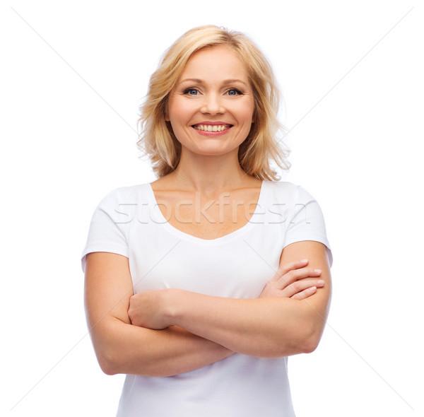 smiling woman in blank white t-shirt Stock photo © dolgachov