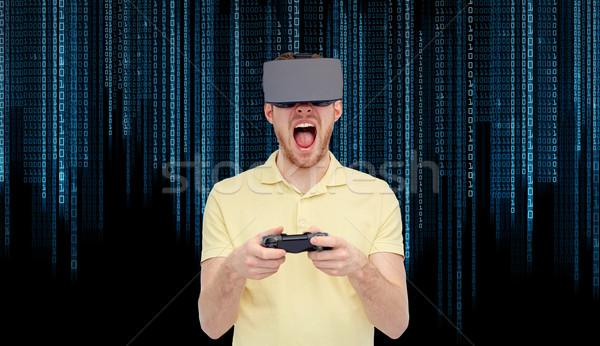 Arrabbiato uomo virtuale realtà auricolare gamepad Foto d'archivio © dolgachov