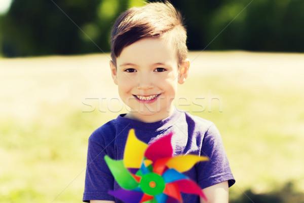 happy little boy with colorful pinwheel at summer Stock photo © dolgachov