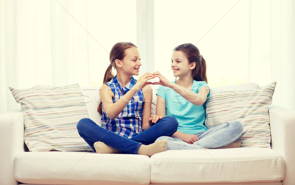 happy little girls showing heart shape hand sign Stock photo © dolgachov