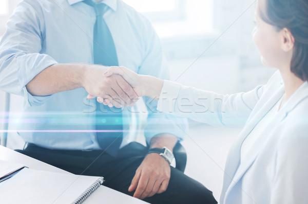 Gente de negocios apretón de manos oficina empresario mujer de negocios negocios Foto stock © dolgachov