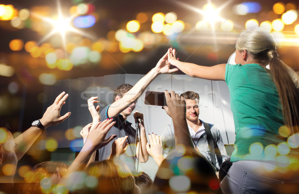 Stock photo: fan making high five with singer at club concert