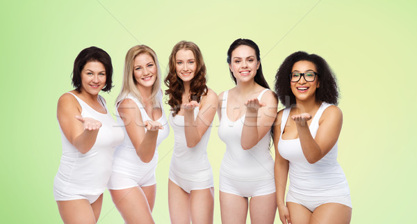 group of happy different women sending blow kiss Stock photo © dolgachov