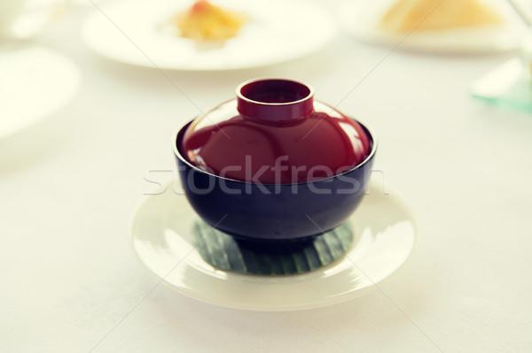 ceramic pot with hot dish on restaurant table Stock photo © dolgachov
