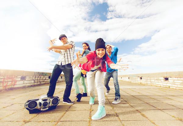 group of teenagers dancing Stock photo © dolgachov