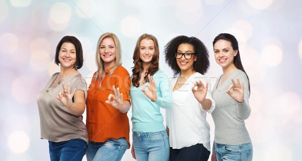 group of happy different size women showing ok Stock photo © dolgachov