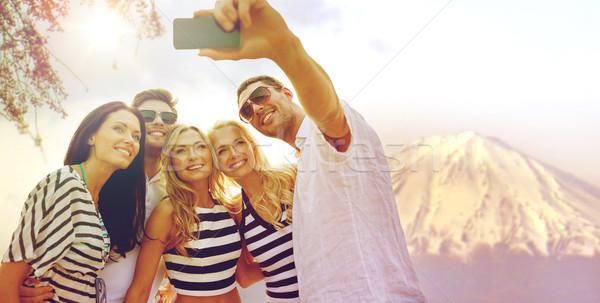 happy friends taking selfie by smartphone in japan Stock photo © dolgachov