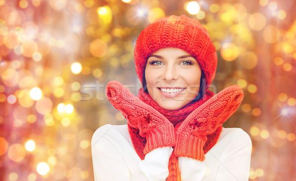 Felice donna Hat sciarpa muffole luci Foto d'archivio © dolgachov