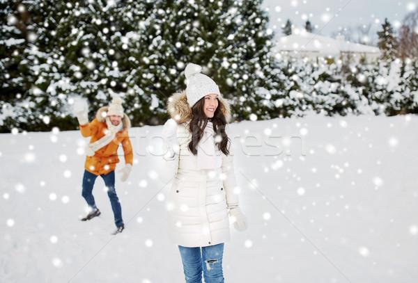 happy couple playing snowballs in winter Stock photo © dolgachov