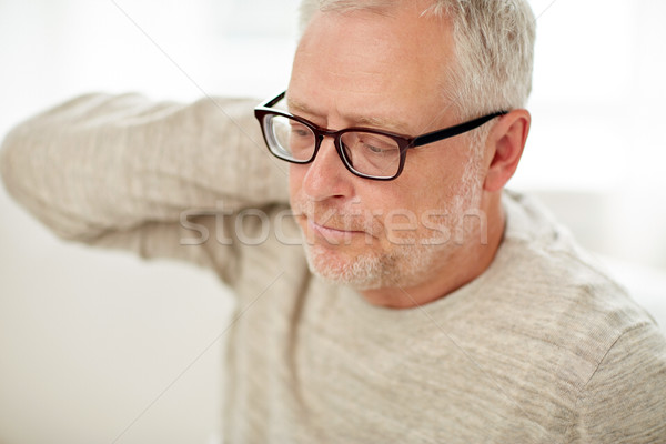 close up of senior man suffering from neck ache Stock photo © dolgachov