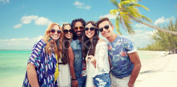 Stock photo: happy hippie friends with selfie stick on beach