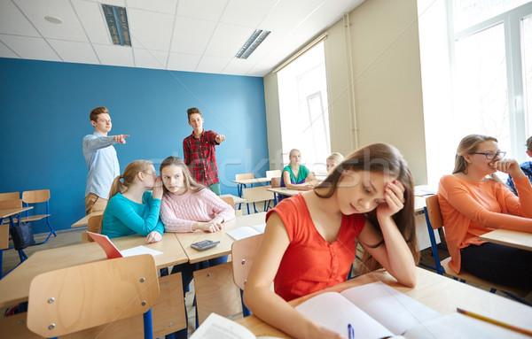 Studenti dietro compagno di classe indietro scuola Foto d'archivio © dolgachov