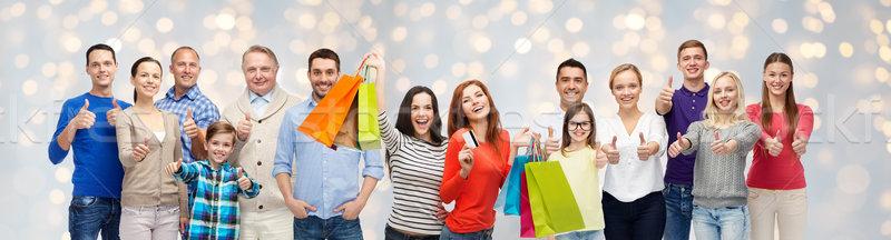 Gelukkige mensen tonen verkoop familie Stockfoto © dolgachov