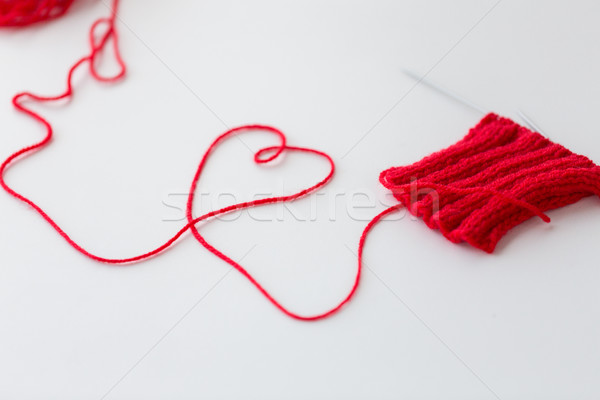knitting needles and thread in heart shape Stock photo © dolgachov