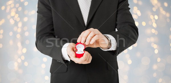 close up of man with engagement ring in gift box Stock photo © dolgachov
