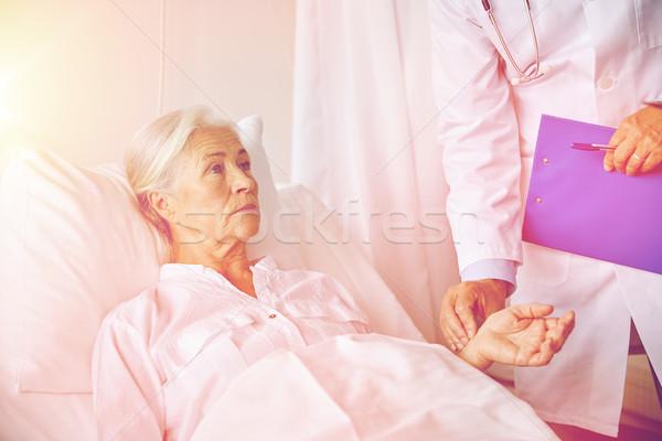 doctor checking senior woman pulse at hospital Stock photo © dolgachov