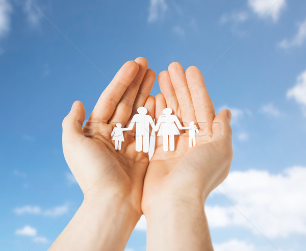 close up of hands holding paper family pictogram Stock photo © dolgachov