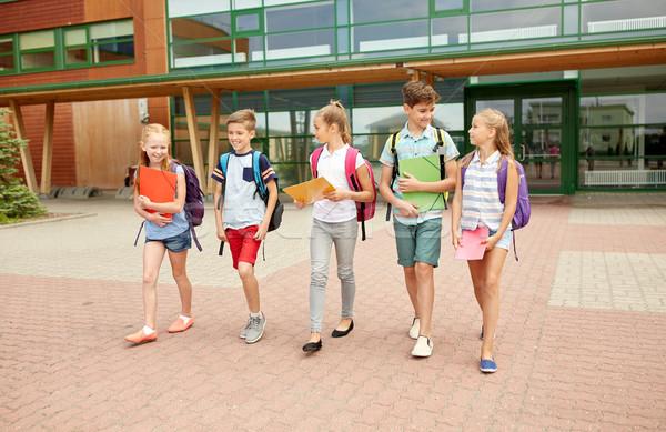 group of happy elementary school students walking Stock photo © dolgachov