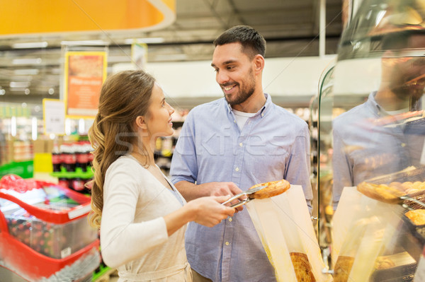 Happy Couple With Shopping Cart At Grocery Store Stock Photo