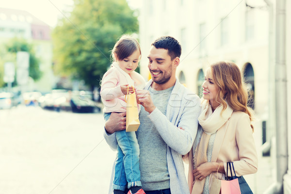 happy family with child and shopping bags in city Stock photo © dolgachov