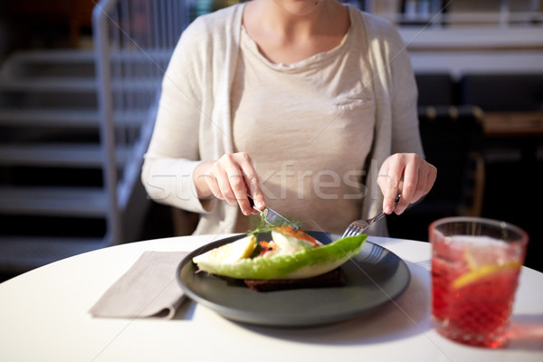 woman eating caviar toast skagen at restaurant Stock photo © dolgachov