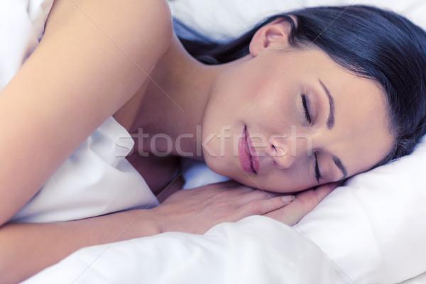 beautiful woman sleeping in bed Stock photo © dolgachov