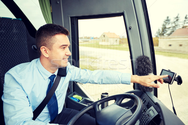 bus driver entering address to gps navigator Stock photo © dolgachov