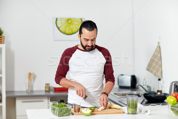 Stock photo: man with blender and fruit cooking at home kitchen