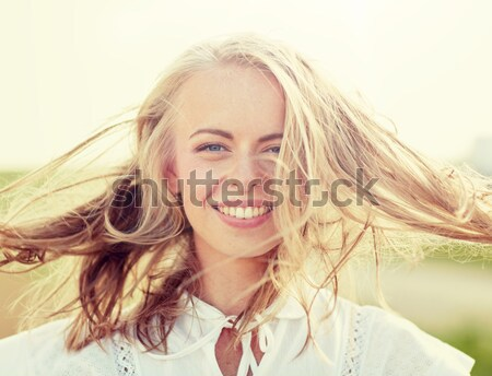 smiling young woman in white on cereal field Stock photo © dolgachov