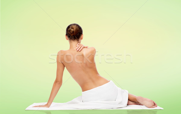 beautiful young woman in white towel with bare top Stock photo © dolgachov