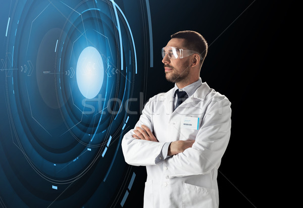 scientist in lab goggles with virtual projection Stock photo © dolgachov