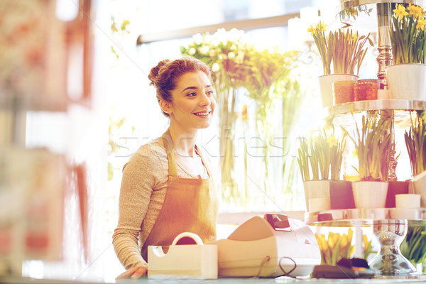 smiling florist woman at flower shop cashbox Stock photo © dolgachov
