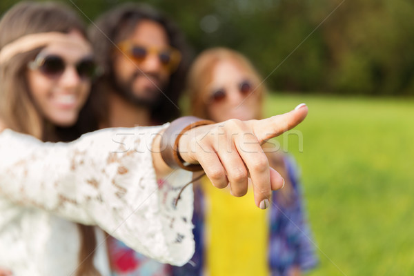 happy hippie woman pointing finger outdoors Stock photo © dolgachov