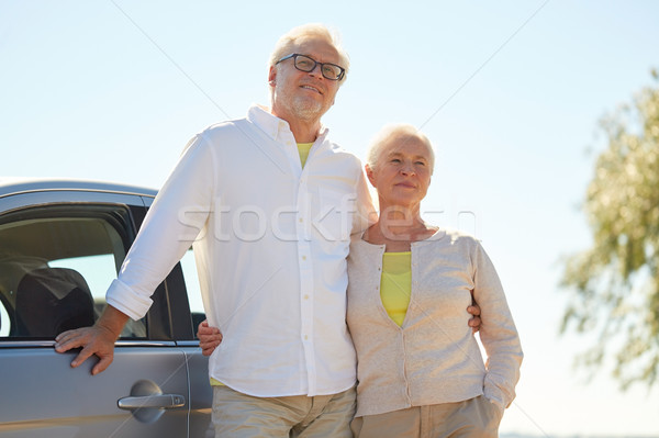 happy senior couple hugging at car in summer Stock photo © dolgachov