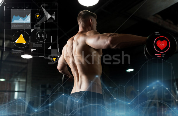 Stock photo: close up of man with dumbbells exercising in gym