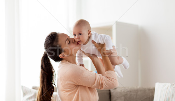 Stock photo: happy mother kissing little baby boy at home