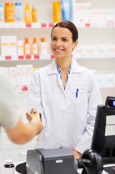apothecary taking credit card at pharmacy cashbox Stock photo © dolgachov