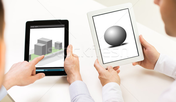 designers with 3d models on tablet pc screens Stock photo © dolgachov