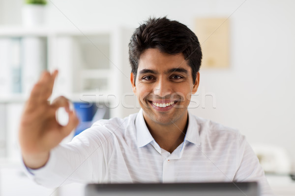 businessman showing ok hand sign at office Stock photo © dolgachov