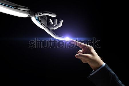robot and human hand connecting fingers Stock photo © dolgachov