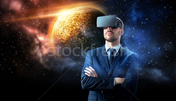 businessman in virtual reality headset over space Stock photo © dolgachov