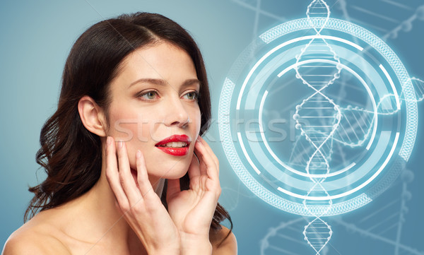 woman with red lipstick over dna molecule Stock photo © dolgachov