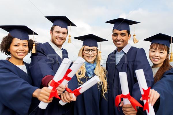 Zdjęcia stock: Szczęśliwy · studentów · edukacji · ukończeniu · ludzi · grupy
