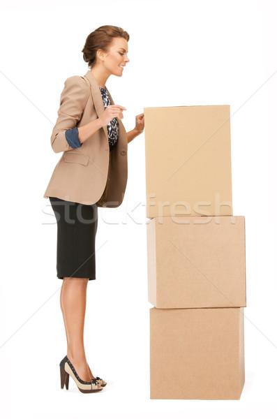 attractive businesswoman with big boxes Stock photo © dolgachov