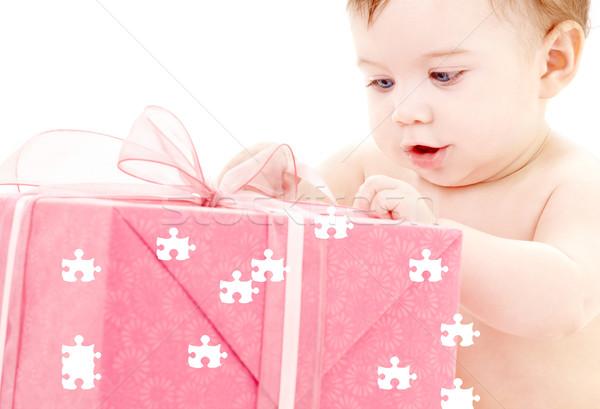 baby boy with puzzle gift box Stock photo © dolgachov