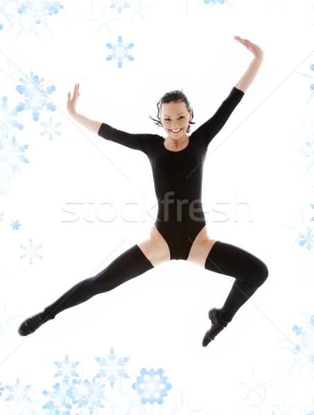 jumping girl in black leotard Stock photo © dolgachov