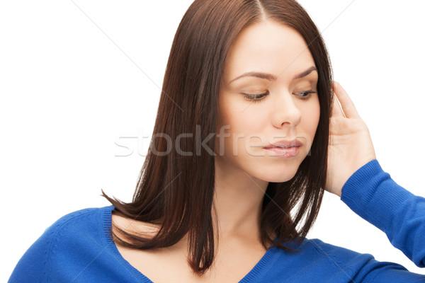 Sérieux femme écouter potins lumineuses photos Photo stock © dolgachov