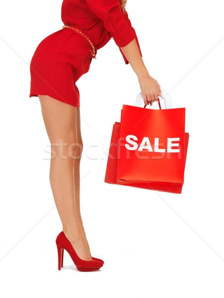 woman on high heels holding shopping bags Stock photo © dolgachov