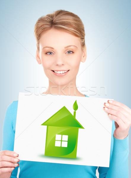 woman with illustration of green eco house Stock photo © dolgachov