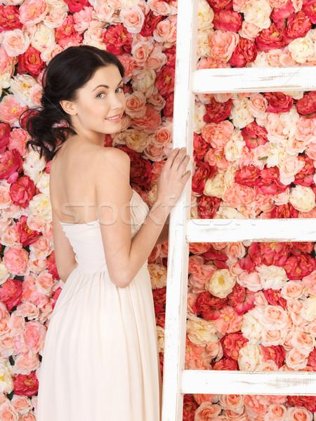 женщину старые лестнице полный роз Сток-фото © dolgachov